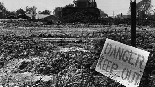 22 May 1980, Niagara Falls, New York State, USA --- Original caption: Clean up efforts have started in the Love Canal. Signs have been posted all over the area with a special warning to all residents to KEEP OUT. Most of the residents have taken that advice and have moved to Motels following a press statement yesterday in Washington. --- Image by © Bettmann/CORBIS